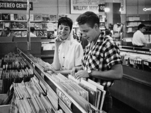 ca. 1959, Los Angeles, California, USA --- Rockabilly singer Eddie Cochran and his fiancee, songwriter Sharon Sheeley, shop for records in a Los Angeles music store in the late 1950s. --- Image by © Douglas Kirkland/CORBIS